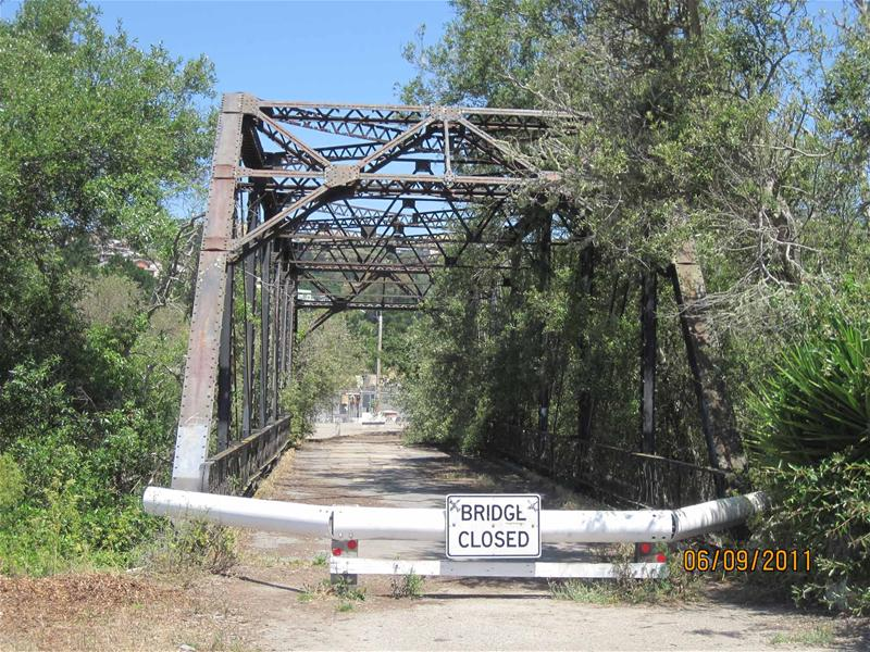 "Bello Bridge with a ""Bridge Closed"" sign"
